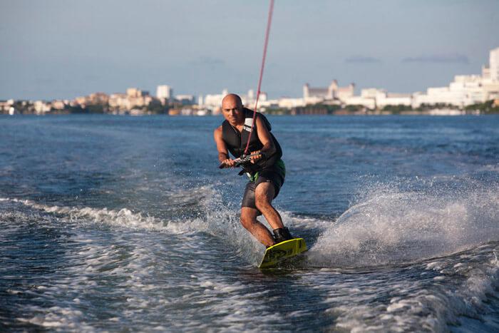 Wake boarding on Nichupte Lagoon, Caribbean Mexican, Cancun, Mexico.