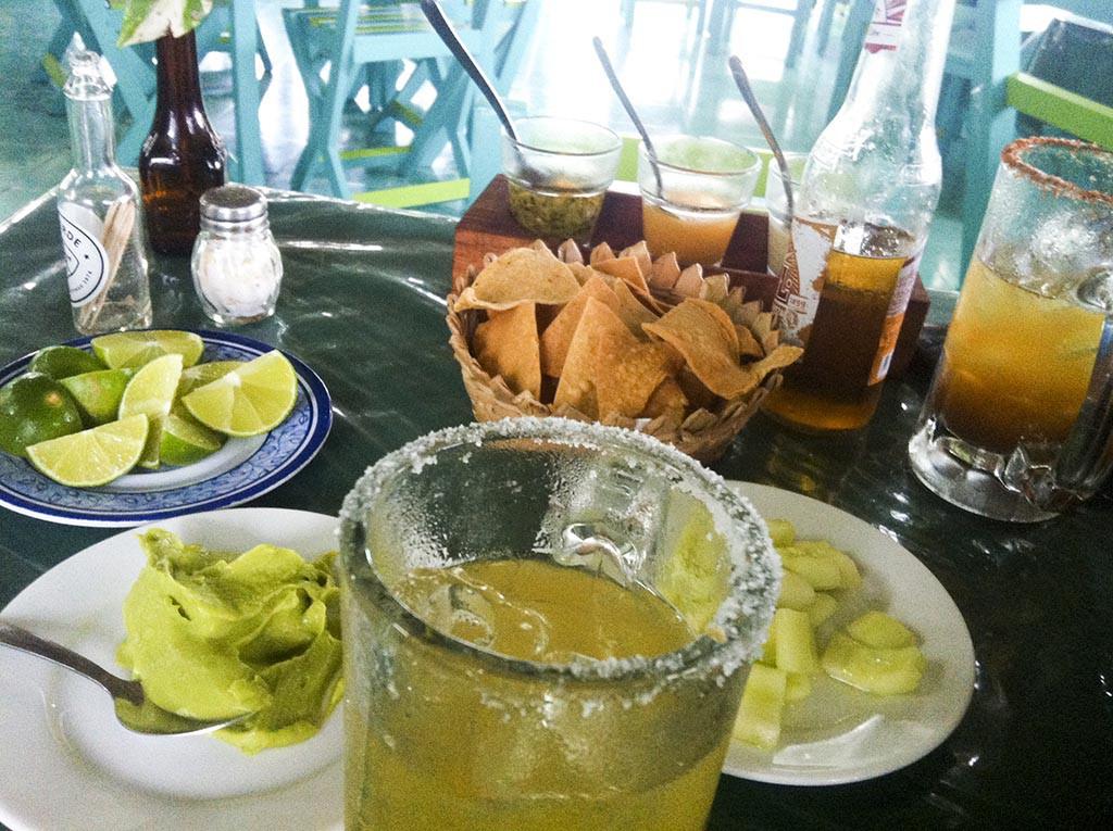 Cheladas and guacamole. Snack from Mexico.-