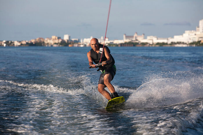 Wake boarding on Nichupte Lagoon, Caribbean Mexican, Cancun, Mexico.